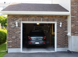 photo of brick home with a 1-car garage