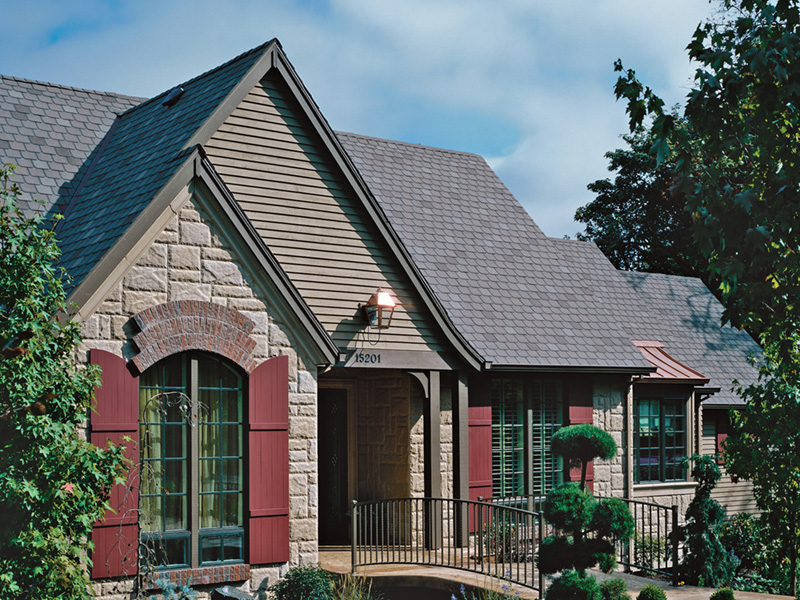 Traditional House Plan Front Photo of House - Champlain Luxury Home 011S-0004 | House Plans and More