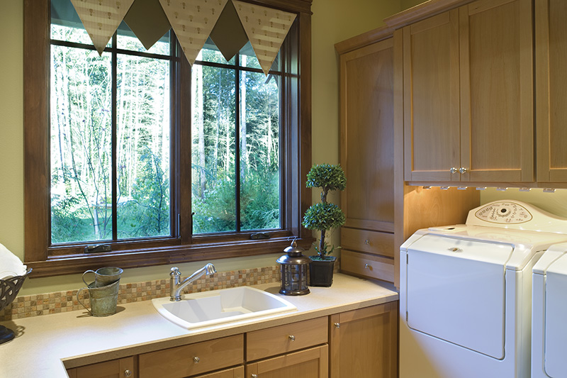 Lake House Plan Laundry Room Photo 01 - Patterson Luxury Craftsman Home 011S-0087 | House Plans and More
