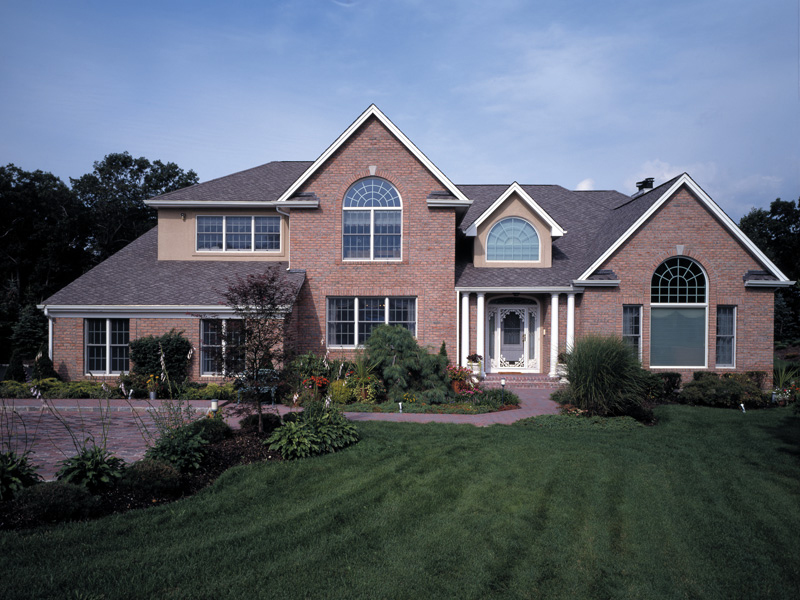 Impressive Gabled Home With Double Columned Entry