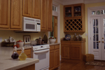 Country House Plan Kitchen Photo 02 - Chappelle Plantation Home 024D-0061 | House Plans and More