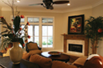 Country French House Plan Family Room Photo 01 - Cash Canyon Acadian Home 024D-0795 | House Plans and More