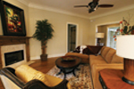 Country French House Plan Family Room Photo 02 - Cash Canyon Acadian Home 024D-0795 | House Plans and More