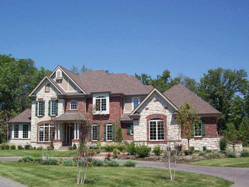 Stone and Brick Combine Creating A Terrific Two-Story Home