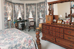 Farmhouse Plan Master Bedroom Photo 01 - Eveline Southern Farmhouse 038D-0006 | House Plans and More
