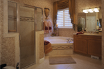Sunbelt Home Plan Master Bathroom Photo 01 - Lakeport Luxury Home 047D-0211 | House Plans and More