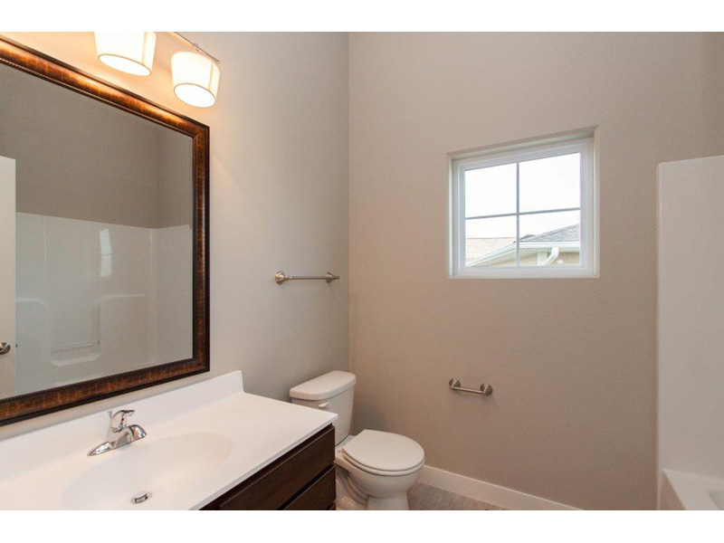 Sunbelt Home Plan Bathroom Photo 01 - Sereno Italian Ranch Home 051D-0831 | House Plans and More