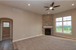 Sunbelt Home Plan Great Room Photo 01 - Sereno Italian Ranch Home 051D-0831 | House Plans and More