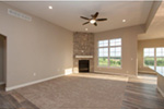 Sunbelt Home Plan Great Room Photo 02 - Sereno Italian Ranch Home 051D-0831 | House Plans and More