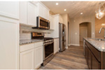 Sunbelt Home Plan Kitchen Photo 05 - Sereno Italian Ranch Home 051D-0831 | House Plans and More