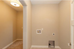 Sunbelt Home Plan Laundry Room Photo 01 - Sereno Italian Ranch Home 051D-0831 | House Plans and More