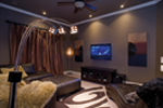 Ranch House Plan Theater Room Photo 01 - Luxury One Story House | Traditional Ranch House