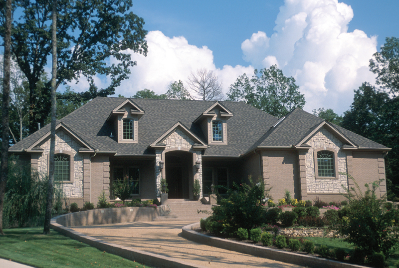 Pretty Stonework Gives This Home A Country French Feel