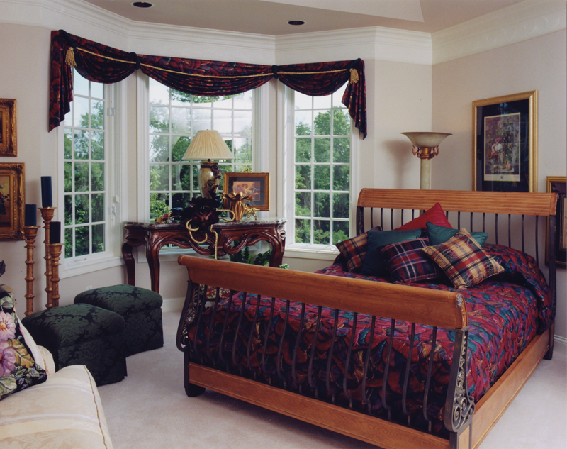 Luxury master bedroom with large bay window.