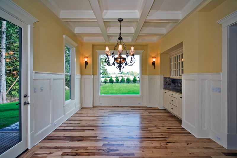 Luxury House Plan Dining Room Photo 01 - Lydelle Luxury Craftsman Home  | Luxury Craftsman Home Designs