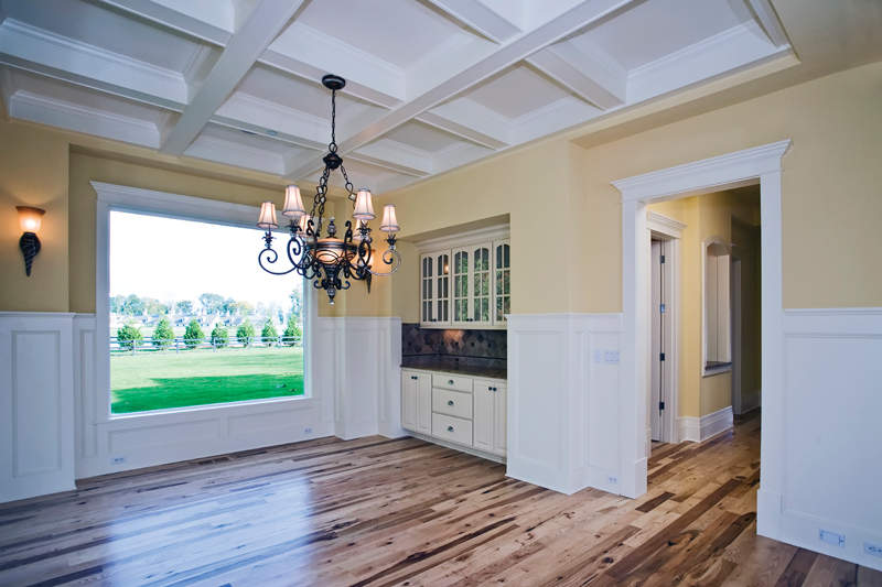 Luxury House Plan Dining Room Photo 02 - Lydelle Luxury Craftsman Home  | Luxury Craftsman Home Designs