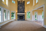 Luxury House Plan Family Room Photo 01 - Lydelle Luxury Craftsman Home  | Luxury Craftsman Home Designs