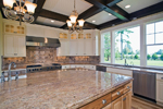 Luxury House Plan Kitchen Photo 01 - Lydelle Luxury Craftsman Home  | Luxury Craftsman Home Designs