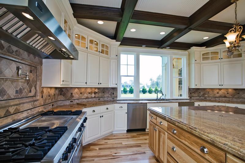 Luxury House Plan Kitchen Photo 02 - Lydelle Luxury Craftsman Home  | Luxury Craftsman Home Designs