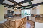 Luxury House Plan Kitchen Photo 03 - Lydelle Luxury Craftsman Home  | Luxury Craftsman Home Designs