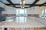 Luxury House Plan Kitchen Photo 05 - Lydelle Luxury Craftsman Home  | Luxury Craftsman Home Designs