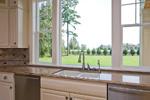 Luxury House Plan Kitchen Photo 08 - Lydelle Luxury Craftsman Home  | Luxury Craftsman Home Designs