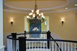 Luxury House Plan Landing Photo - Lydelle Luxury Craftsman Home  | Luxury Craftsman Home Designs