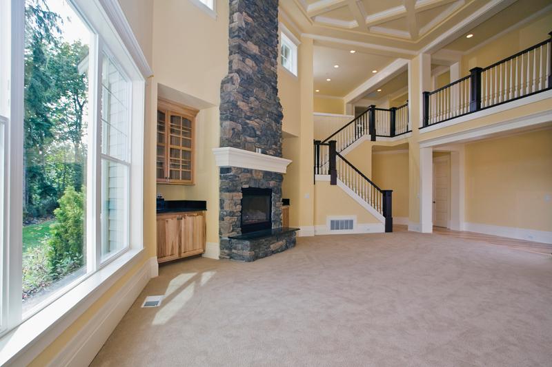 Luxury House Plan Living Room Photo 02 - Lydelle Luxury Craftsman Home  | Luxury Craftsman Home Designs