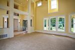 Luxury House Plan Living Room Photo 03 - Lydelle Luxury Craftsman Home  | Luxury Craftsman Home Designs