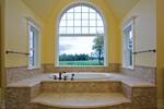Luxury House Plan Master Bathroom Photo 01 - Lydelle Luxury Craftsman Home  | Luxury Craftsman Home Designs
