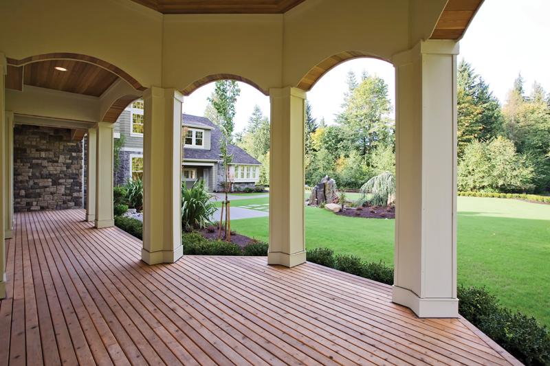 Luxury House Plan Porch Photo - Lydelle Luxury Craftsman Home  | Luxury Craftsman Home Designs