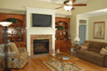 Luxury House Plan Family Room Photo 02 - Lemonwood Arts And Crafts Home 076D-0204 | House Plans and More