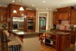 Luxury House Plan Kitchen Photo 01 - Lemonwood Arts And Crafts Home 076D-0204 | House Plans and More