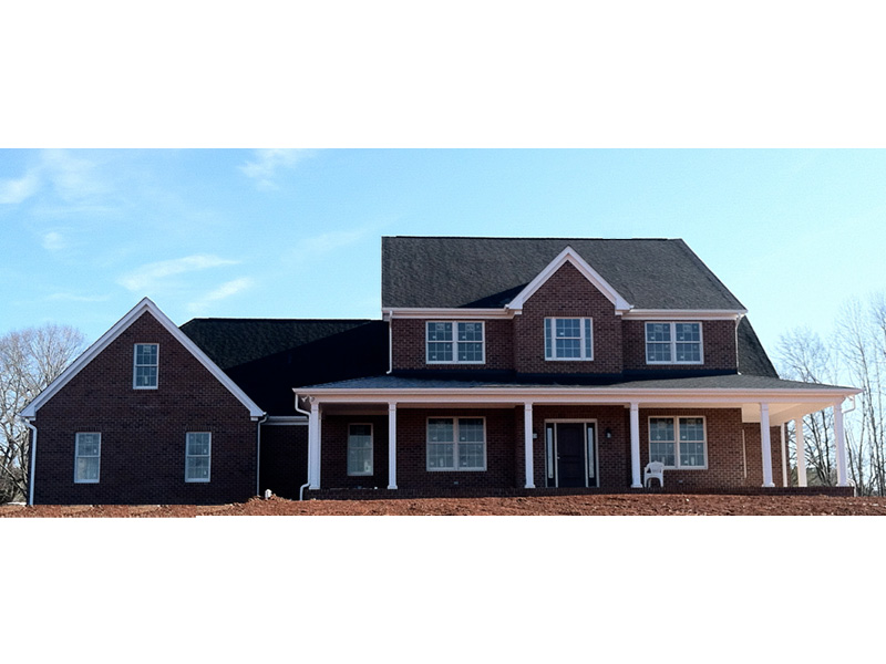 Colonial House Plan Front Photo 01 - Stonewood Lane Country Home 077D-0283 | House Plans and More