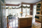 Country French House Plan Kitchen Photo 01 - Avanti Acadian Country Home 082S-0003   House Plans and More