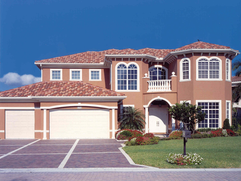Luxury Two-Story Stucco Home With Exquisite Large Arched Windows