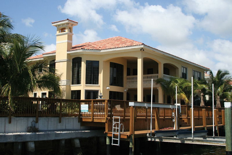 Sunbelt Home Plan Rear Photo 02 - Picayne Point Waterfront Home 106S-0067 | House Plans and More