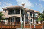 Sunbelt Home Plan Rear Photo 04 - Picayne Point Waterfront Home 106S-0067 | House Plans and More